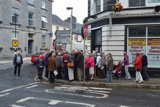 Photo:Ballinrobe's Market House, Ulster Bank and Abbey Street being examined by group