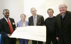Photo:Ballyouskill Vita Friends of Fr. Kevin Doheny group presented a giant cardboard cheque for €9,000 to Vita. They had raised the funds from events held throughout the year. From l-r are: Asfaw Merkuria, Kathleen Mooney, Frank Brennan, chairman of Ballyouskill Vita Friends of Fr. Kevin Doheny group, Patsy Cody, Ballyouskill, Fr. Norman Fitzgerald, Cssp, president and co-founder with Fr. Kevin Doheny, Ballinakill, of Vita, formerly The Irish Refugee Trust.