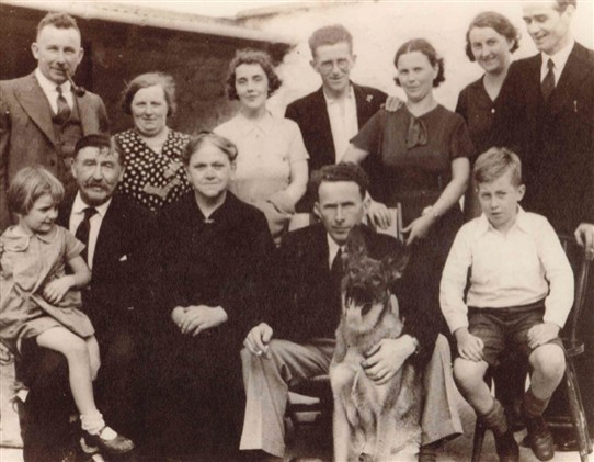 Photo:Eliza is the lady third from the left (bottom row) dressed in black. Her husband Jamesy is to her left.