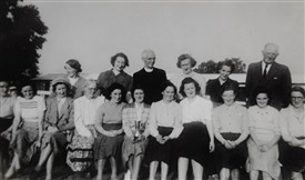 Photo:Josie who won the Gunnigan Cup (for golf) is seated holding her trophy with left to right back row: Eva Murphy, Nellie May, Canon Gunnigan, Miss O'Malley, Peggy Murphy and Edward Fitzgerald. Front Aileen Higgins, Nattie McTigue, Mrs Mona Fitzgerald, Mrs Leyden, Sis Fleming, Josie Winner, Josie Fitzpatrick, July O'Rourke, Peggy May, Mrs Una McSweeney, and Ann Flannery nee May.