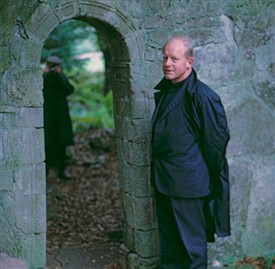 Photo:Fr Valkenburg is standing beside the doorway of the 11th century ruined chapel on Inchagoill Island.