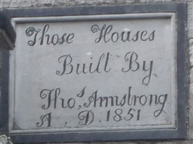Photo:Cut Stone plaque on houses