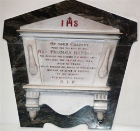 Photo:Memorial within St. Mary's Catholic Church of Rev. T. Hardiman d. 1874 markes the location of his original grave which was originally outside the Church before extensions were added.  Other members of the Clergy are buried outside within the grounds of St. Mary's Church