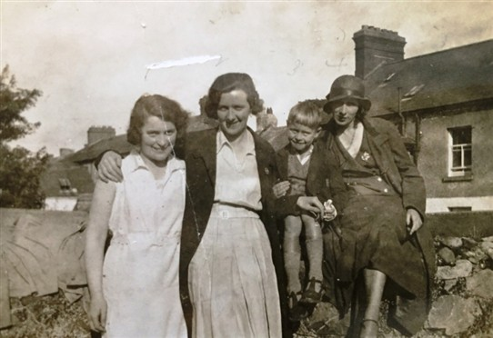 Photo:Alice Newman, Meg Kearns, Jimmy Morris & Mammie Behan possibly taken in Abbey St garden