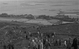Photo:1950s image of climbing the Reek with the islands of Clew Bay in the background