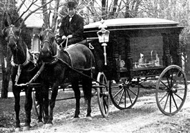 Photo:Black horse drawn hearse